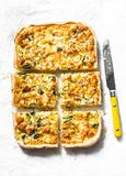 Salmon, leek, spinach, cheese puff pastry tart, pie on light background stock photos
