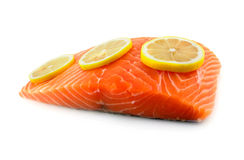 Salmon with lemon. Raw salmon fillet with lemon Royalty Free Stock Image