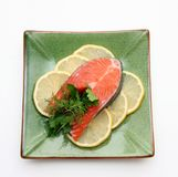 Salmon with lemon. And parsley on plate Royalty Free Stock Photo