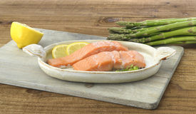 Salmon with lemon and asparagus Royalty Free Stock Image