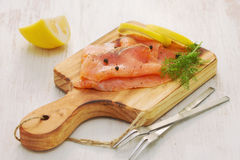 Salmon with lemon and black pepper Royalty Free Stock Image