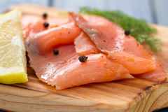 Salmon with lemon and black pepper Royalty Free Stock Photography
