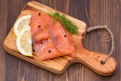 Salmon with lemon and black pepper Stock Photos