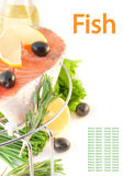 Salmon, lemon and olives on a grill Royalty Free Stock Photography