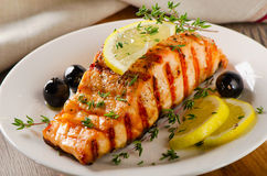 Salmon with lemon, olives and  herbs Stock Image