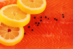 Salmon lemon and pepper background. Closeup Stock Photos