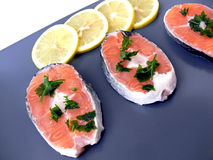 Salmon and lemon on plate Stock Photo