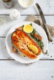 Salmon with lemon on a plate Royalty Free Stock Photo
