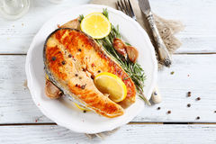 Salmon with lemon on a plate Stock Image