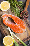 Salmon, lemon and spices closeup. Royalty Free Stock Images