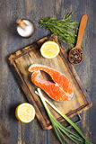 Salmon, lemon and spices. Royalty Free Stock Photography