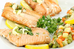 Salmon with lemon and vegetables Stock Photos