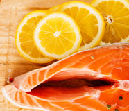 Salmon. With lemon on wooden board Stock Photo