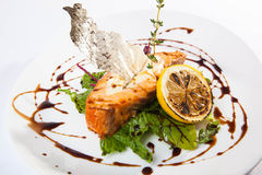 Salmon on lettuce with lemon. And sauce Stock Photo
