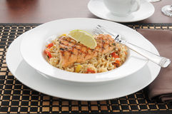 Salmon with lime and rice Stock Images