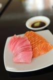 Salmon and maguro sashimi on white dish Stock Images