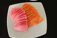 Salmon and maguro sashimi on white dish Royalty Free Stock Image