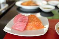 Salmon and maguro sashimi on white dish Stock Photography