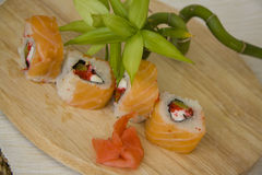 Salmon maki on plate with bamboo green Stock Images