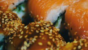 Salmon maki roll. Japanese sushi cuisine with fresh raw fish.Japanese dish consisting of rice, salmon or tuna,shrimp and stock video footage