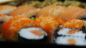 Salmon maki roll. Japanese sushi cuisine with fresh raw fish.Japanese dish consisting of rice, salmon or tuna,shrimp and. Macro salmon maki roll. Japanese sushi stock video footage