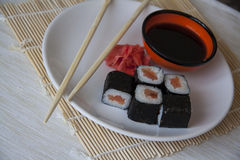 Salmon maki on straw matt Stock Image