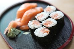 Salmon Maki sushi, Japanese food. Salmon Maki sushi on wooden tray royalty free stock photo