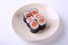 Salmon maki sushi on ceramic dish isolated on white background Royalty Free Stock Photography