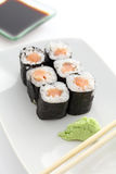 Salmon Maki sushi with chopsticks Stock Photos