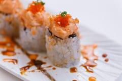 Salmon Maki Topping with Salmon Tatare and Ebiko.  Stock Photography