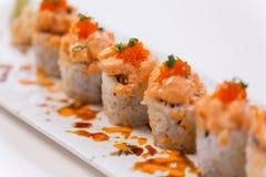 Salmon Maki Topping with Salmon Tatare and Ebiko.  Royalty Free Stock Image