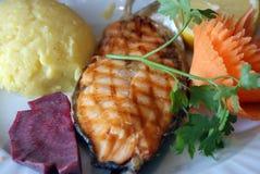 Salmon with mamaliga Stock Photos