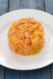 Salmon with mango on white plate Stock Photo
