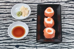 Salmon Mayo rolll ,Salad cream in salmon topped shrimp eggs. Stock Photos