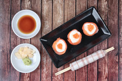 Salmon Mayo rolll ,Salad cream in salmon topped shrimp eggs. Royalty Free Stock Photo