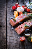 Salmon meal. Raw salmon meat and ingredients on wooden bacground,selective focus Royalty Free Stock Photography