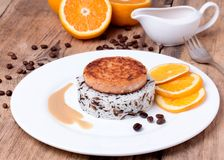 Salmon medallion with mixed cooked rice on white plate Royalty Free Stock Image