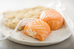 Salmon mousse parcels. Wrapped in smoked salmon Stock Photo