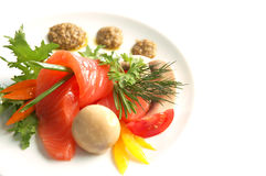 Salmon with mushrooms. On plate isolated on white background Stock Image