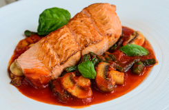 Salmon with mushrooms and cherry tomato sauce Royalty Free Stock Image