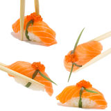 Salmon nigiri. Isolated on white background in chopsticks Royalty Free Stock Images