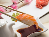 Salmon nigiri. Isolated on white background in chopsticks Stock Photography