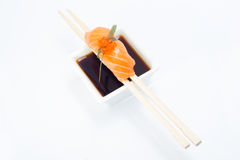 Salmon nigiri. Isolated on white background in chopsticks Stock Images
