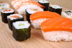 Salmon Nigiri and Maki sushi with cucumber Stock Photography