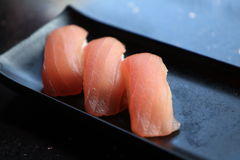 Salmon nigiri. Three tune nigiri sushi on a black plate Stock Photos