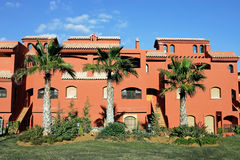 Salmon or orange apartments on Spanish urbanisation Stock Photography