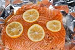 Salmon with orange slices. Raw salmon with orange slices in the baking pan ready for cooking Stock Image