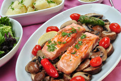 salmon with organic mushroom on a plate Royalty Free Stock Images