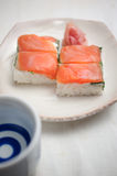 Salmon oshizushi and sake Royalty Free Stock Images