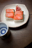 Salmon oshizushi and sake Royalty Free Stock Image
